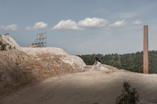 closer-to-the-matter-halfbuild-billboard-and-chimney-image-by-markus-lehr